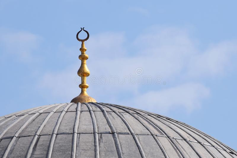 Mosque Dome with a Golden Moon. A mosque in Istanbul Turkey with the focus on the dome and the golden minaret at the top stock photo