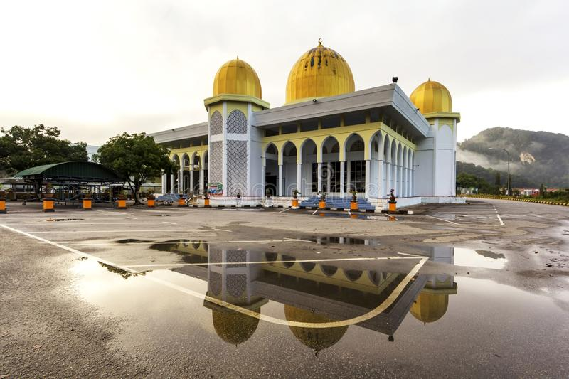 A mosque and its reflection on a water. The mosque is located in a town of Gua Musang, in a state of Kelantan, Malaysia royalty free stock image