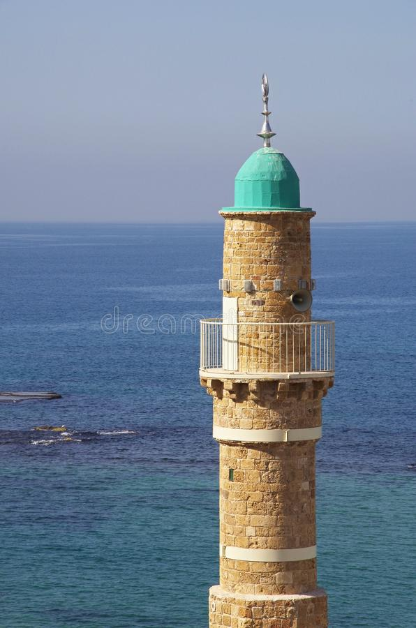 Mosque in Jaffa, Tel Aviv. Minaret of Al-Bahr Mosque in Jaffa, Tel Aviv and the Mediterranean Sea in the background royalty free stock images