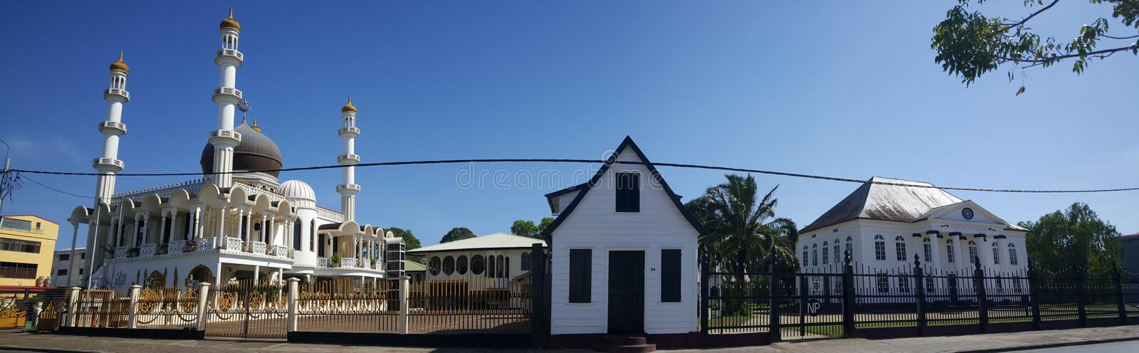 Mosque Keizerstraat and the adjacent Neveh Shalom Synagogue. In Paramaribo Suriname Panorama royalty free stock photos
