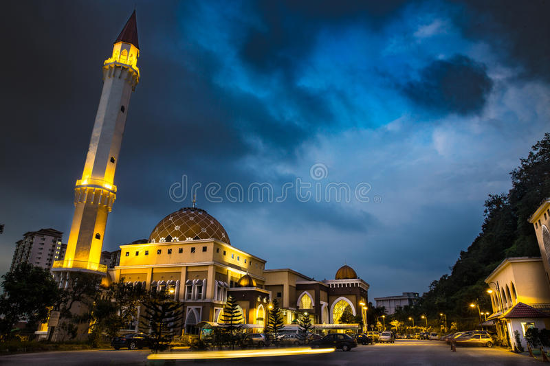 Mosque at Malaysia. Usamah bin Zaid during Maghrib prayer at Wangsa Maju - evening Shot when the cloud of the nature are yet to dark but the artificial lamp is royalty free stock photo
