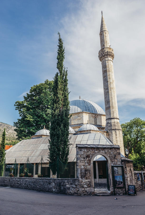 Mosque in Mostar. Mostar, Bosnia and Herzegovina - August 25, 2015. Karagoz Bey Mosque in Mostar renovated after damages during Bosnian War royalty free stock image