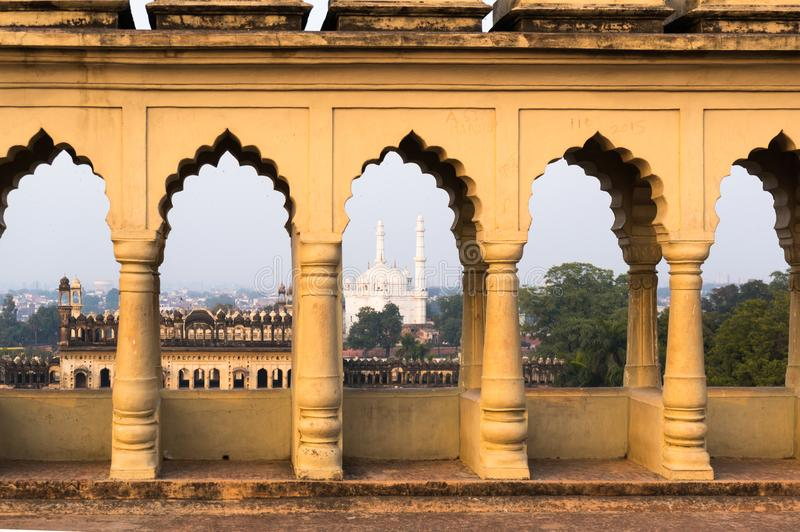 Mosque seen through the arches of the bara imambara in lucknow. Mosque of white marble seen through the arches on the roof of the bara imambara in lucknow. This stock photography