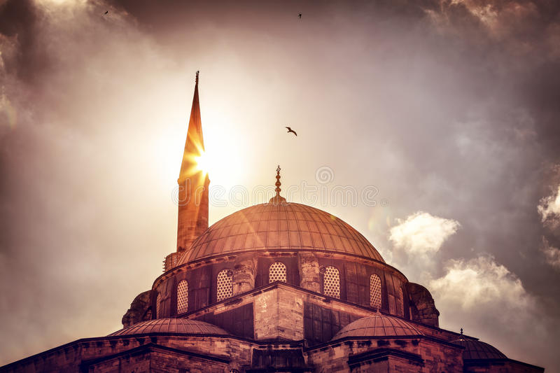 Mosque silhouette over sunset. Beautiful view on the mosque over sunset light, amazing architectural heritage, historical landmark of Istanbul, Turkey royalty free stock photos