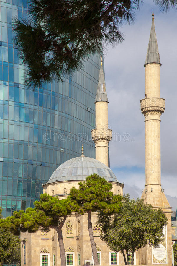 Mosque and skyscraper royalty free stock photo