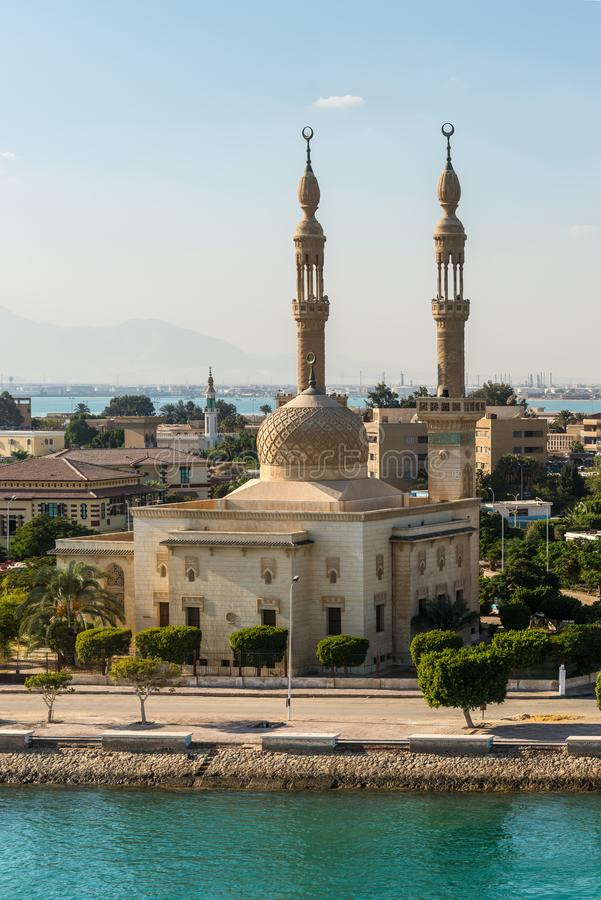 Mosque on the Suez Canal in Egypt. Suez, Egypt - November 5, 2017: An Egyptian Mosque  at the city of Tawfiq Suburb of Suez, Eqypt on the southern end of the royalty free stock photos