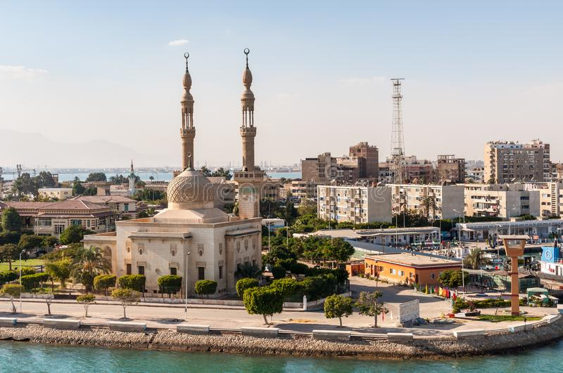 Mosque on the Suez Canal in Egypt. Suez, Egypt - November 5, 2017: An Egyptian Mosque and maritime port at the city of Tawfiq Suburb of Suez, Eqypt on the stock photos