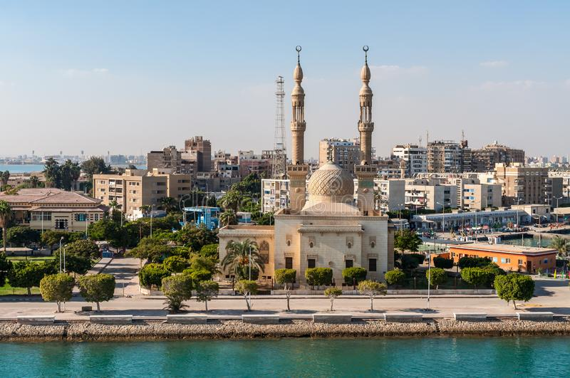 Mosque on the Suez Canal in Egypt. Suez, Egypt - November 5, 2017: An Egyptian Mosque and maritime port at the city of Tawfiq Suburb of Suez, Eqypt on the royalty free stock images