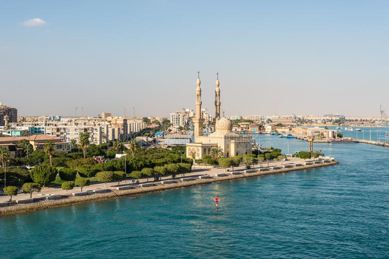 Mosque on the Suez Canal in Egypt. Suez, Egypt - November 5, 2017: An Egyptian Mosque and maritime port at the city of Tawfiq Suburb of Suez, Eqypt on the stock image