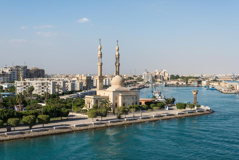 Mosque on the Suez Canal in Egypt. Suez, Egypt - November 5, 2017: An Egyptian Mosque and maritime port at the city of Tawfiq Suburb of Suez, Eqypt on the royalty free stock photo