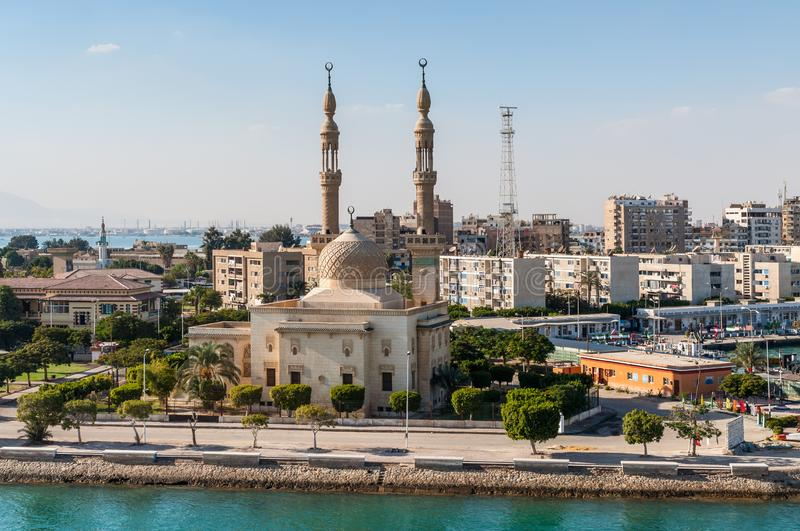 Mosque on the Suez Canal in Egypt. Suez, Egypt - November 5, 2017: An Egyptian Mosque and maritime port at the city of Tawfiq Suburb of Suez, Eqypt on the stock images
