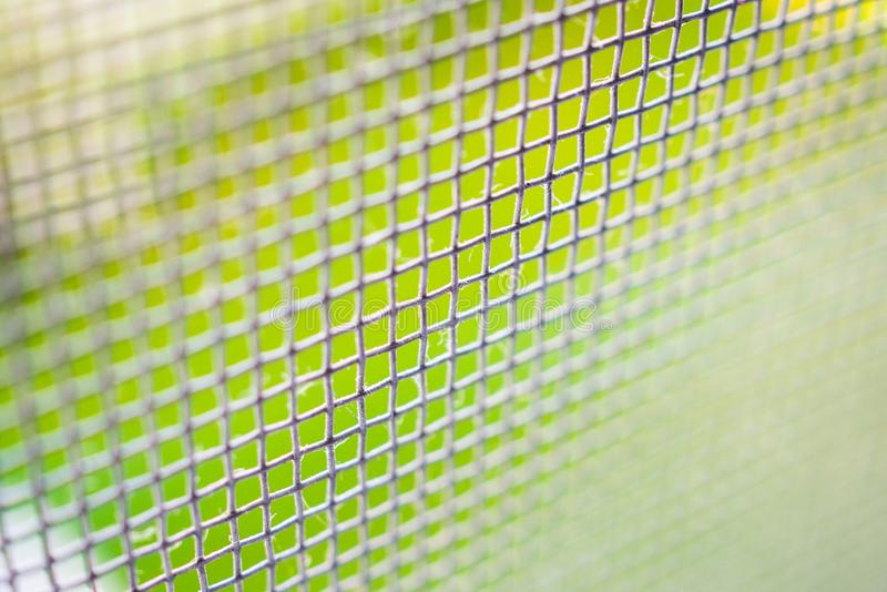 Mosquito net wire screen closeup on house window protection against insect. Mosquito net wire screen close up on house window protection against insect stock image