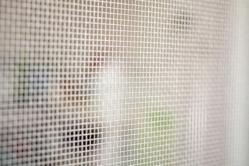Mosquito net wire screen closeup on house window protection against insect. Mosquito net wire screen close up on house window protection against insect royalty free stock photo