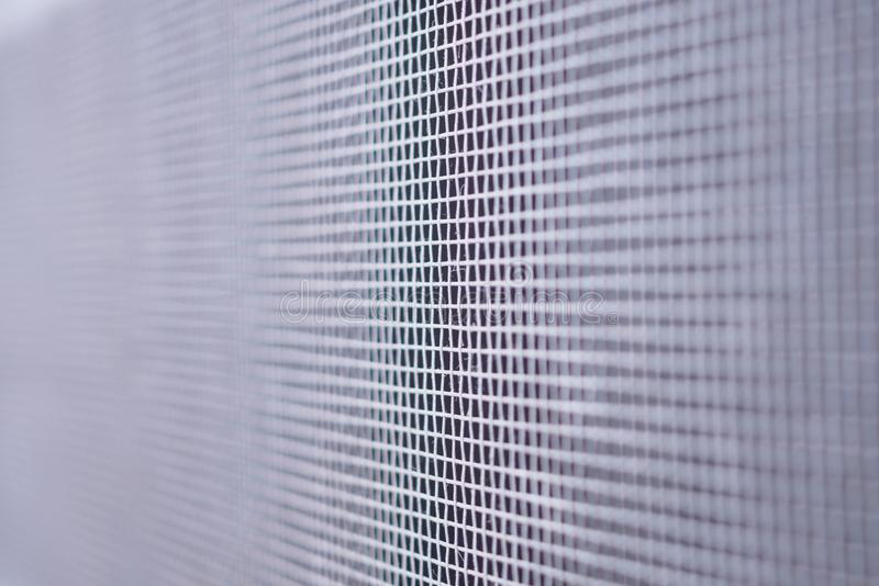Mosquito net wire screen closeup on house window protection against insect. Mosquito net wire screen close up on house window protection against insect royalty free stock image
