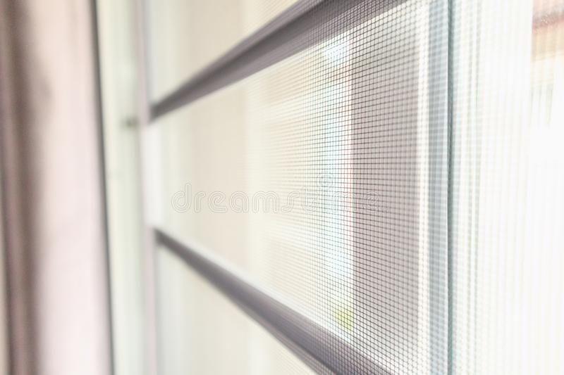 Mosquito net wire screen on house window protection. Against insect stock photos