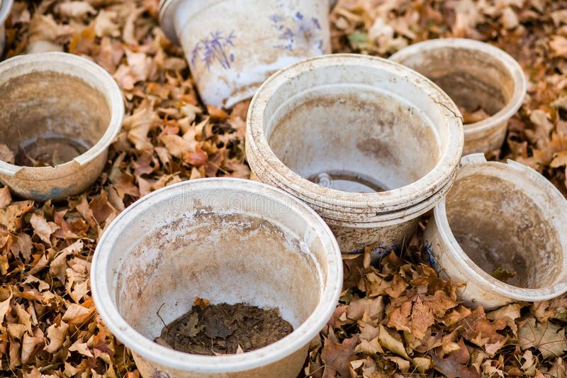Abandoned the flowerpot. Moss covered terracotta plant pots and fragments in a garden royalty free stock images