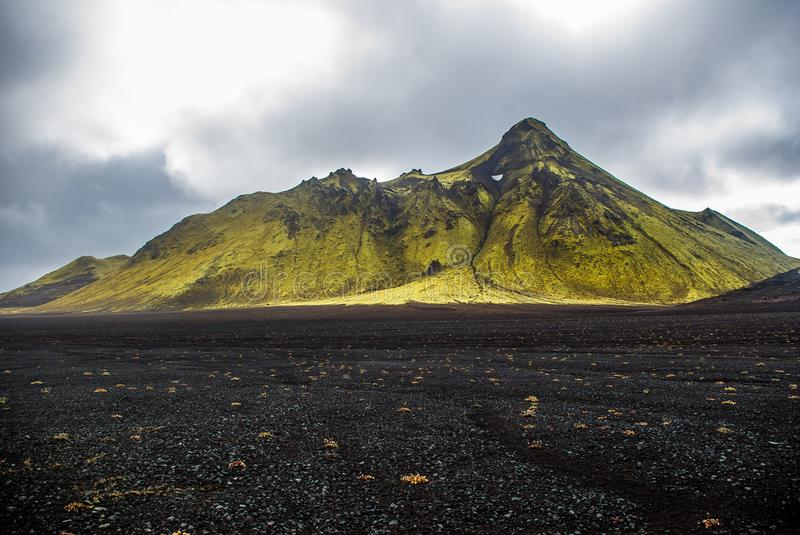 Moss mountain and ash black desert in central Iceland Landmannalaugar trail royalty free stock image