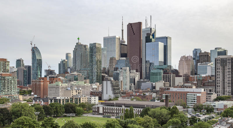 Moss Park and Toronto Skyline. Evening view from a high-rise building of Moss Park Arena with nearby buildings,Toronto's Financial District skyscrapers and CN royalty free stock photography