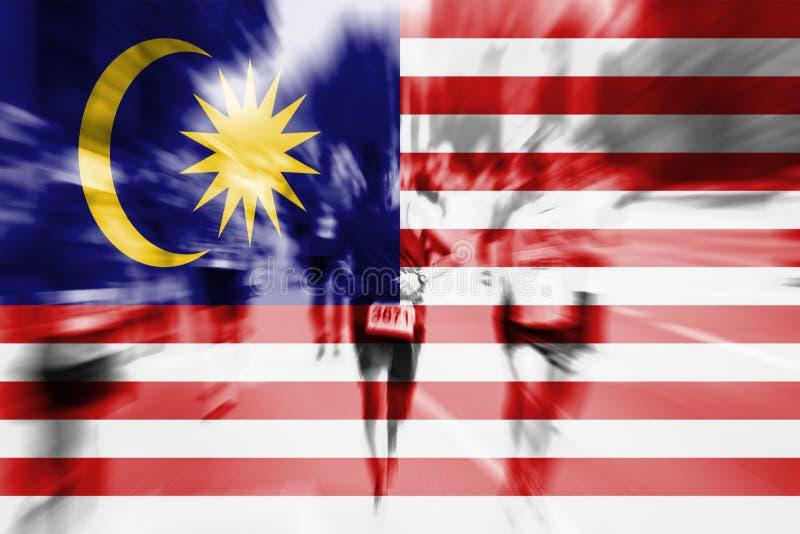 Mosso del corridore maratona con il mescolamento della bandiera della Malesia fotografia stock