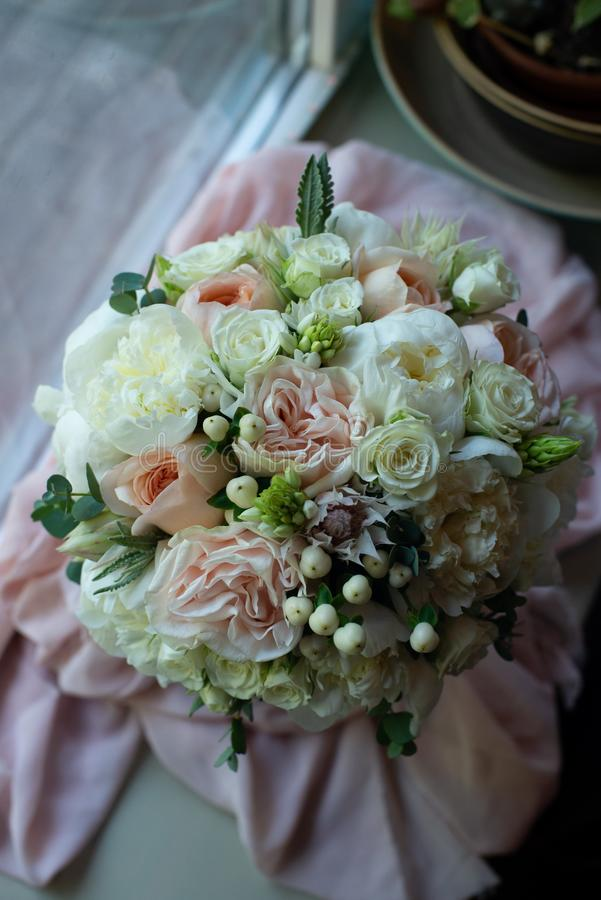 Bouquet of flowers on a leg in the interior of the restaurant for a celebration shop floristry or wedding salon royalty free stock photos