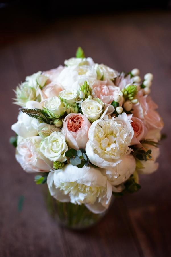 Bouquet of flowers on a leg in the interior of the restaurant for a celebration shop floristry or wedding salon royalty free stock photo