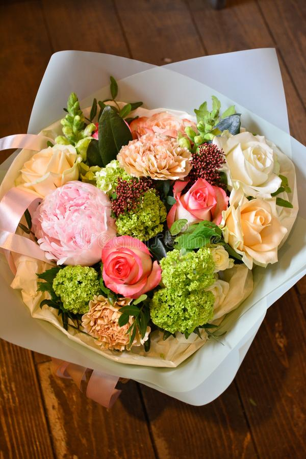Bouquet of flowers on a leg in the interior of the restaurant for a celebration shop floristry or wedding salon stock photography