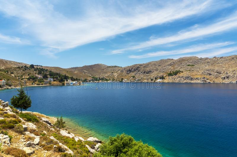 Magic Bay on Symi Island. Among the most beautiful small islands in Greece is the island of Symi. Just 8 kilometers from Rhodes, just 8 kilometers from the royalty free stock photo