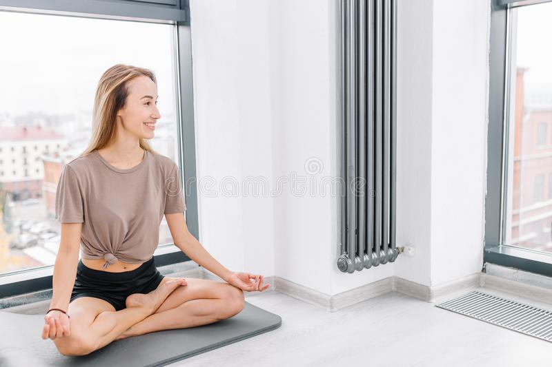 The most comfortable position for yoga loves. Copy space. daily shedule. girl performing the full Padmasana posture royalty free stock photo