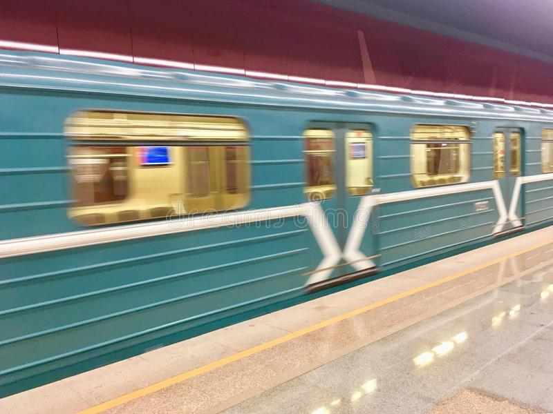 Blurred moving Moscow Metro Train. The most common Moscow Metro train design operating in 90th, 2000nds and 2010th in Moscow, Russia stock photos