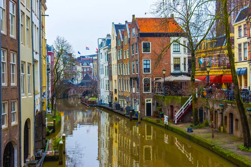 The most famous canals and embankments of Utrecht city at winter. General view of the cityscape and traditional Netherlands architecture stock photo