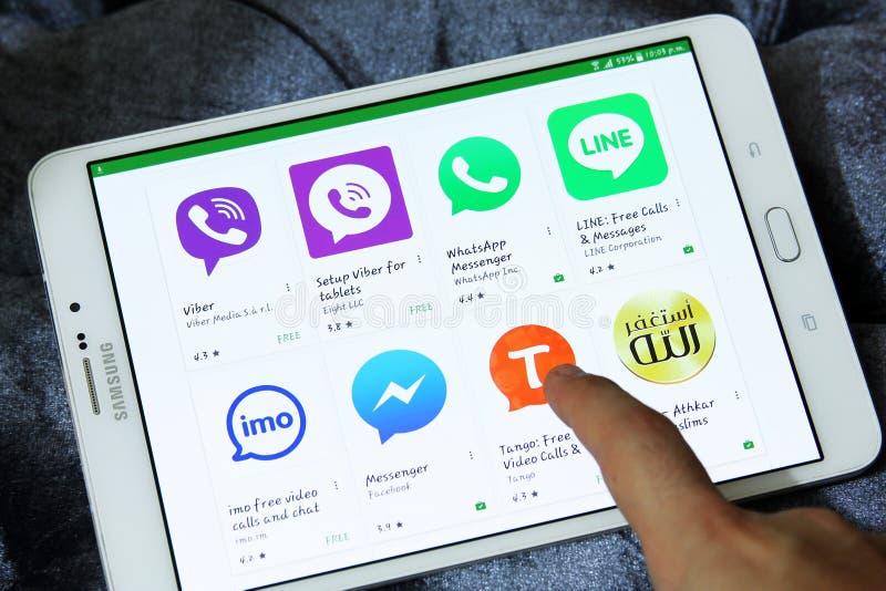 Most famous messenger applications on google play. Browsing top famous messenger applications on google play on samsung tab s2 like line, viber, skype,imo royalty free stock image