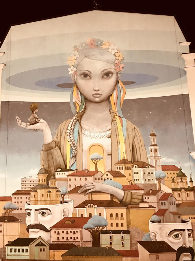The most famous Ukrainian Mural in Podil - WOMAN - PODIL - KYIV - NIGHT - UKRAINE royalty free stock photography