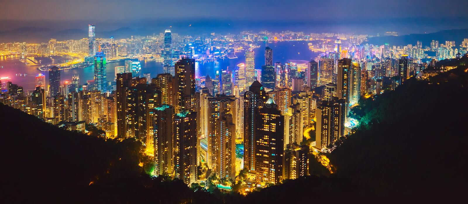 The most famous view of Hong Kong at twilight sunset. Hong Kong skyscrapers skyline cityscape view from Victoria Peak illuminated. In the evening. Hong Kong stock photography