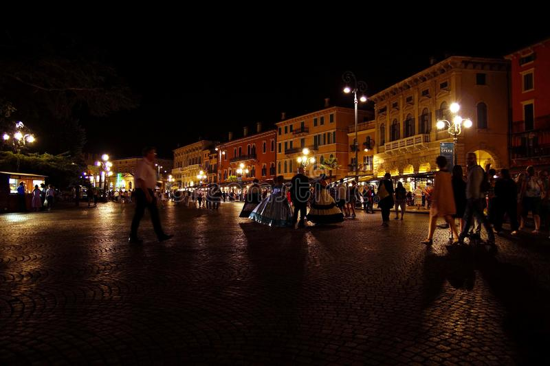 Verona at night, opera women in lush dresses, ball gowns. Piazza Bra at evening, stock photography