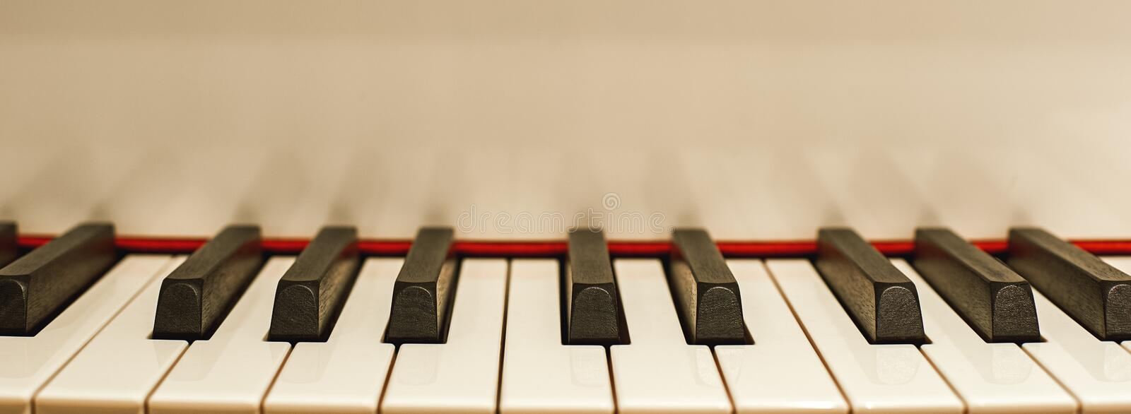 The most melodious musical instrument. Close up view of black and white piano keys. Music concept royalty free stock image