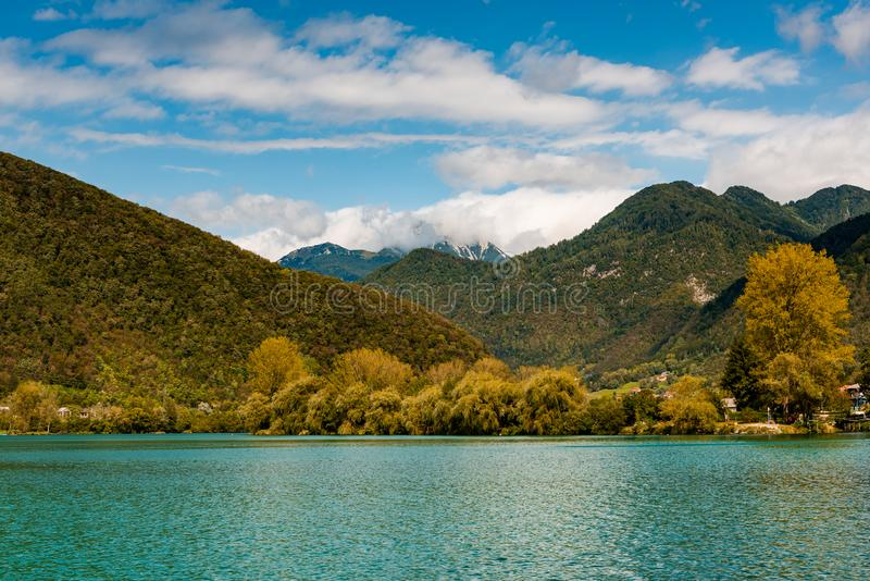 Most Na Soci Emerald Lake and Autumnal Forest, Slovenia. Alps, blue, europe, fall, famous, green, hills, julian, landscape, meadow, mountains, nature, outdoor royalty free stock images
