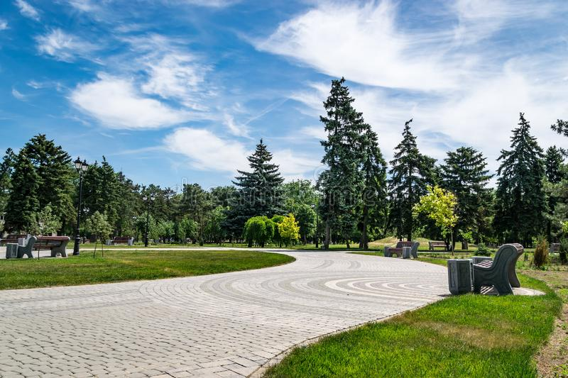 The most romantic landscape park garden.Comfortable walking path goes through the green grassy lawn royalty free stock photo