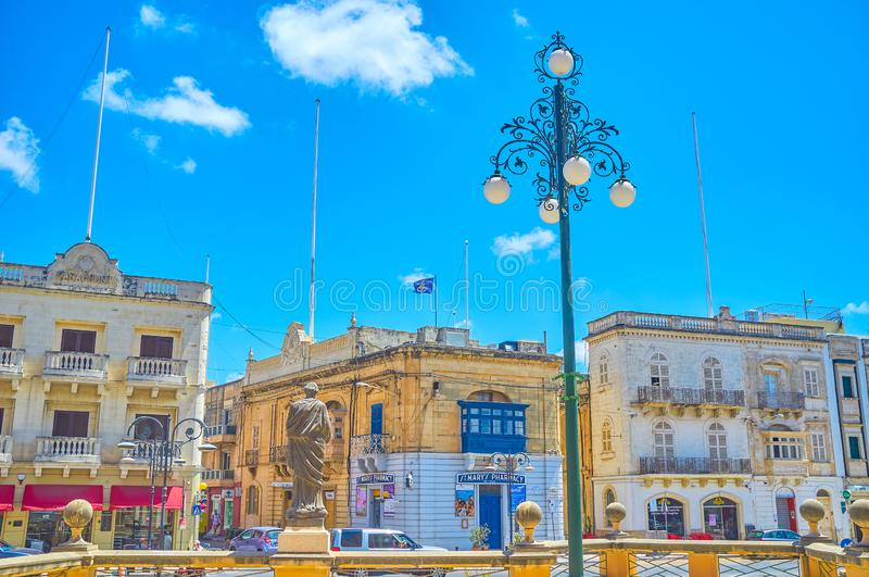 The sculpture of the Saint in Mosta, Malta. MOSTA, MALTA - JUNE 14, 2018: The sculpture of the Saint, located on the pedestal of Basilica Rotunda and faces on stock photo