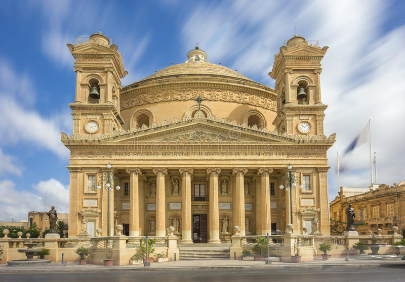 Mosta, Malta - The Mosta Dome at daylight. Mosta, Malta - The Church of Assumption of our Lady also know as Mosta Dome at daylight with moving clouds royalty free stock photos
