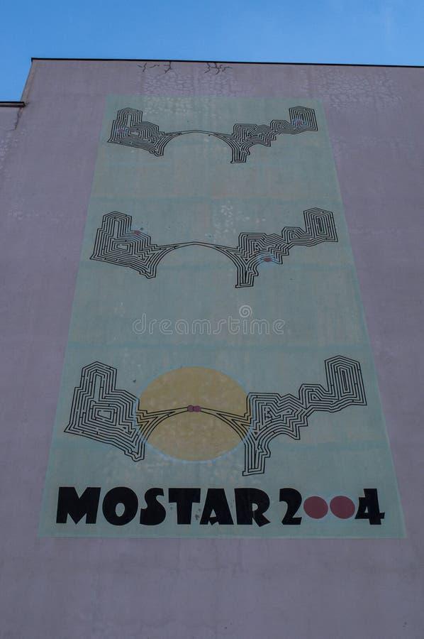 Mostar, Stari Most, Old Bridge, poster, graffiti, mural, Bosnia and Herzegovina, Europe, street art, skyline, Bosnian War. Mostar, Bosnia, 07/07/2018: a giant stock photos