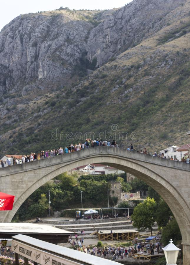 Crowd of people of the famous Mostar bridge in summer season royalty free stock photos