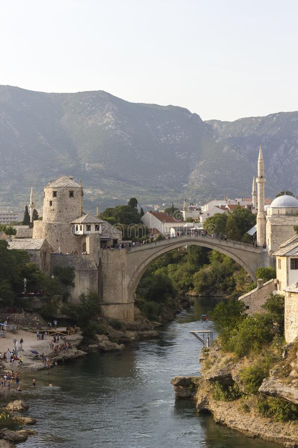 Overview of Stari Most bridge at sunset. MOSTAR, BOSNIA AND HERZEGOVINA - AUGUST 16 2017: Overview of Stari Most bridge at sunset, with bosnian hills in the royalty free stock photos
