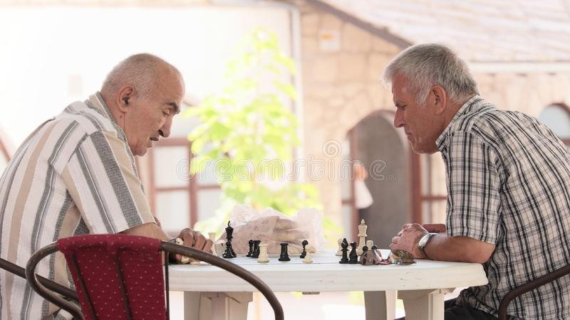 Senior Men Play Chess stock image