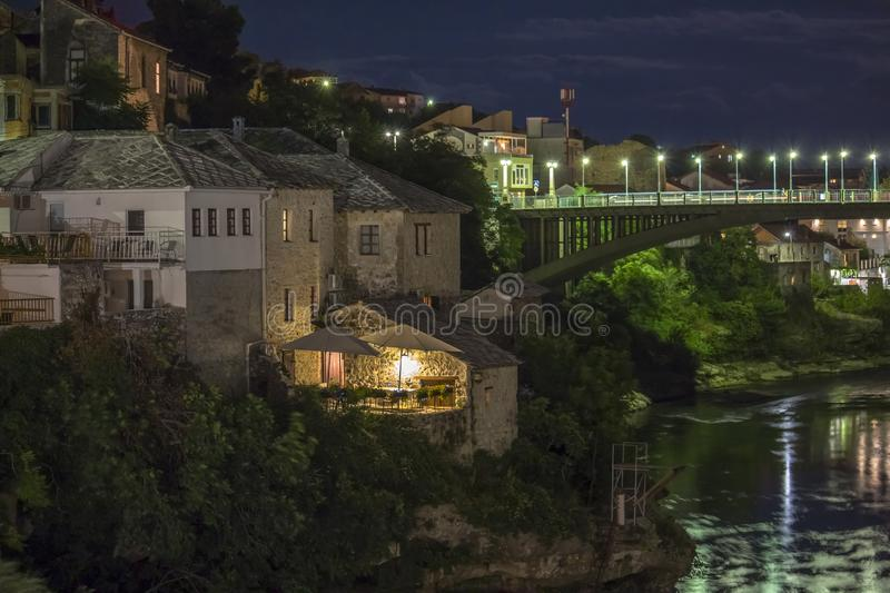 Mostar, Bosnia and Herzegovina at night . The Old Bridge, Stari Most, with emerald river Neretva.  stock photo