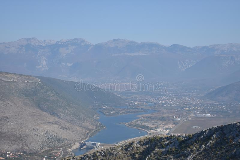 The Mostar hydropower plant on the Neretva river. The mountain Prenj in the distance,Bosnia and Herzegovina royalty free stock photo