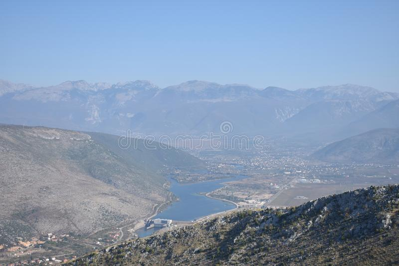 The Mostar hydropower plant on the Neretva river. The mountain Prenj in the distance,Bosnia and Herzegovina royalty free stock image