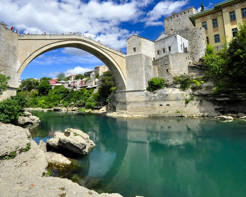 Mostar main bridge with river. Main bridge in Mostar City with blue sky, turquise river and sunny weather royalty free stock photo