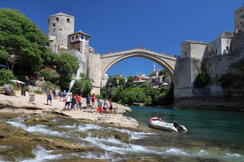 Mostar Old Bridge. MOSTAR, BOSNIA AND HERZEGOVINA - JUNE 29, 2019: People visit the Old Town of Mostar. The area surrounding Mostar Old Bridge (Stari Most) is a stock photography