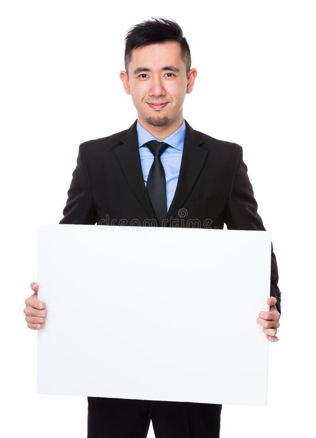 Mostra asiática do homem de negócios com bandeira branca fotos de stock royalty free
