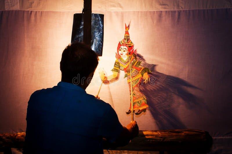 Mostra de fantoche da sombra de Tailândia fotografia de stock